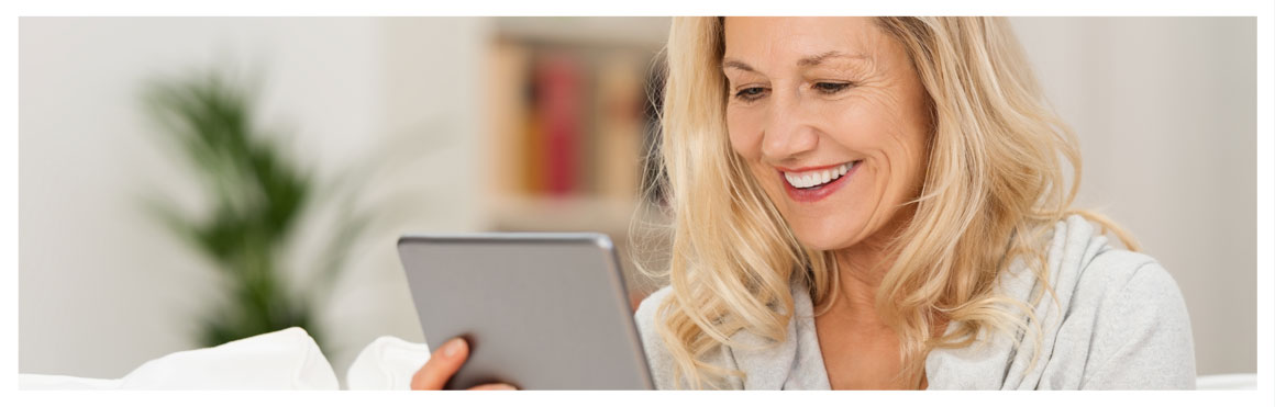 image of women smiling and looking at tablet